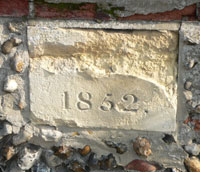 The missing element is believed to be TGC, as the inn was owned by Thomas Gery Cullum at the time. This is from the wall surrounding the Tollgate Inn, Fornham Road, Bury St Edmunds